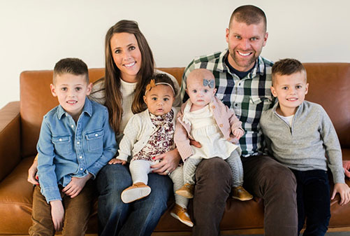 Photo of Ashley and Andy with their two sons and two daughters